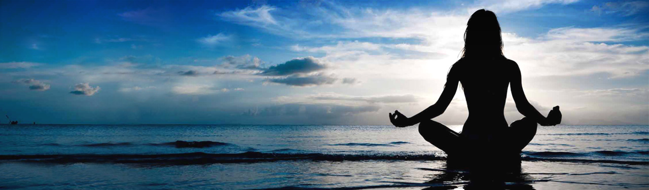 yoga-sea-beach-woman-doing-breath-retention-pose-web-header